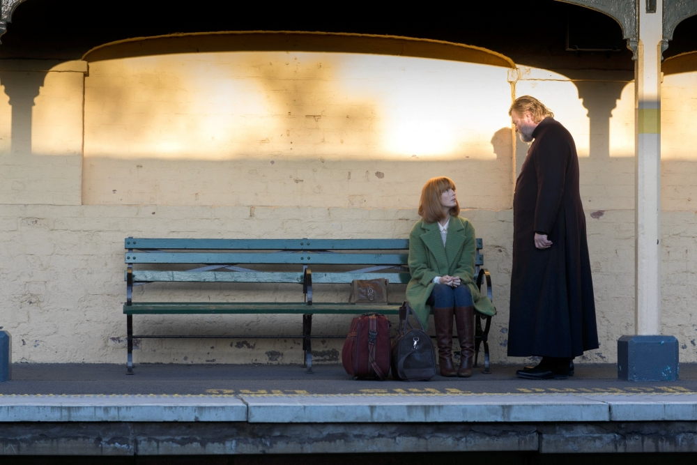 calvary-2013-009-father-james-standing-over-fiona-on-train-station-bench