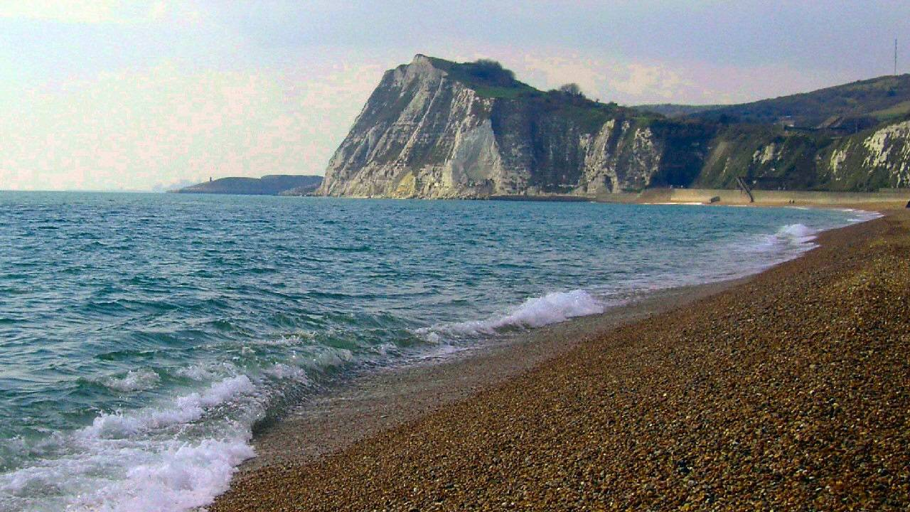 """dover beach connotation Where is dover beach what is the speaker looking at who is the speaker to whom is the speaking how is the speaker feeling what connotations are associated with """"cliffs."""