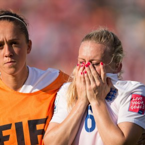 England's Jo Potter (L) consoles teammate Laura Bassett after she scored an own-goal in the last minutes of the game giving Japan the win in their semifinal match at the FIFA Women's World Cup at Commonwealth Stadium in Edmonton, Canada on July 1, 2015.   AFP PHOTO/GEOFF ROBINS        (Photo credit should read GEOFF ROBINS/AFP/Getty Images)
