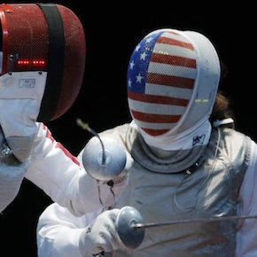 Ines Boubakri of Tunisia, left and Nicole Ross of the United States compete in the round of 32 during women's fencing at the 2012 Summer Olympics, Saturday, July 28, 2012, in London. (AP Photo/Andrew Medichini)